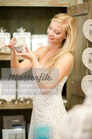 Smiling woman shopping in store Stock Photo - Premium Royalty-Free, Image code: 614-06537060