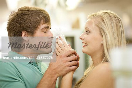 Couple smelling candles in store Stock Photo - Premium Royalty-Free, Image code: 614-06537078