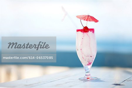 Close up of tropical drink on table Stock Photo - Premium Royalty-Free, Image code: 614-06537085