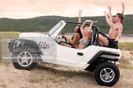 Friends driving jeep on sand dune Stock Photo - Premium Royalty-Free, Image code: 614-06537086