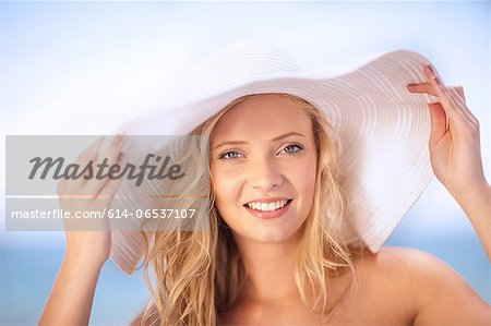 Woman wearing floppy hat outdoors Stock Photo - Premium Royalty-Free, Image code: 614-06537107