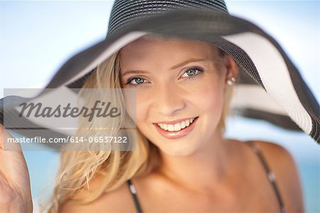 Woman wearing floppy hat outdoors Stock Photo - Premium Royalty-Free, Image code: 614-06537122