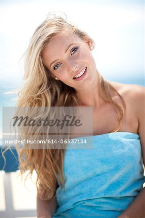 Smiling woman sitting outdoors Stock Photo - Premium Royalty-Free, Image code: 614-06537134
