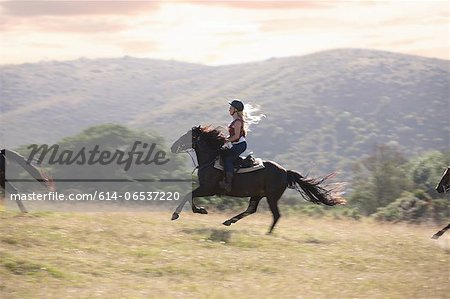 Woman riding horse in rural landscape Stock Photo - Premium Royalty-Free, Image code: 614-06537220