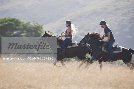 Couple riding horses in rural landscape Stock Photo - Premium Royalty-Free, Image code: 614-06537225