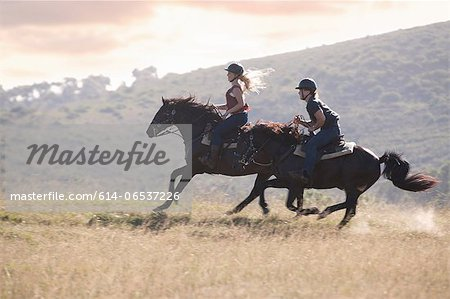 Couple riding horses in rural landscape Stock Photo - Premium Royalty-Free, Image code: 614-06537226