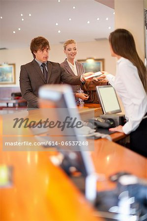 Business people checking into hotel Stock Photo - Premium Royalty-Free, Image code: 614-06537248