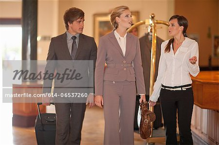 Business people walking in hotel lobby Stock Photo - Premium Royalty-Free, Image code: 614-06537260