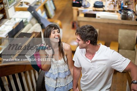 Couple shopping together in thrift store Stock Photo - Premium Royalty-Free, Image code: 614-06537270