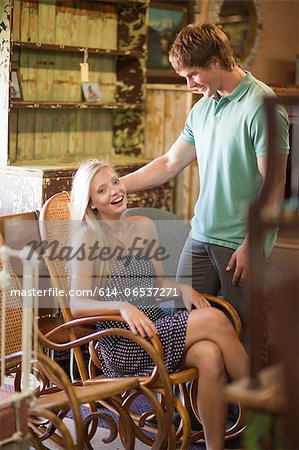 Couple shopping together in thrift store Stock Photo - Premium Royalty-Free, Image code: 614-06537271