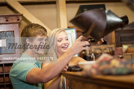 Couple shopping together in thrift store Stock Photo - Premium Royalty-Free, Image code: 614-06537278