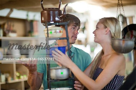 Couple shopping together in thrift store Stock Photo - Premium Royalty-Free, Image code: 614-06537281