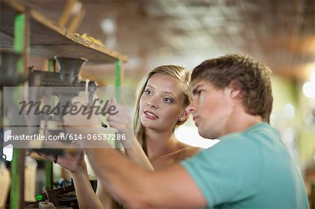 Couple shopping together in thrift store Stock Photo - Premium Royalty-Free, Image code: 614-06537286