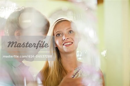 Couple shopping together in store Stock Photo - Premium Royalty-Free, Image code: 614-06537288