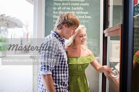 Couple window shopping for jewelry Stock Photo - Premium Royalty-Free, Image code: 614-06537305