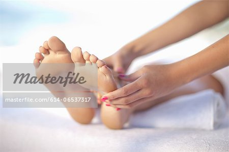 Woman having foot massage Stock Photo - Premium Royalty-Free, Image code: 614-06537317