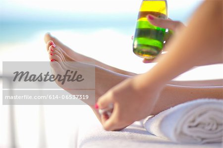 Woman having pedicure Stock Photo - Premium Royalty-Free, Image code: 614-06537319