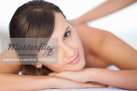 Smiling woman having massage Stock Photo - Premium Royalty-Free, Image code: 614-06537322