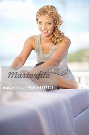 Smiling woman giving massage outdoors Stock Photo - Premium Royalty-Free, Image code: 614-06537323