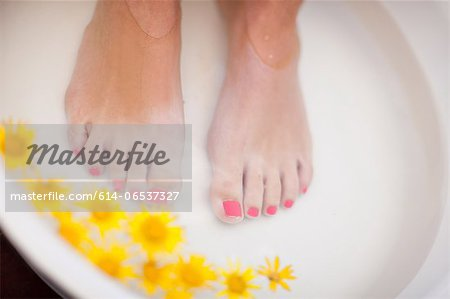 Woman's feet soaking in tub Stock Photo - Premium Royalty-Free, Image code: 614-06537327