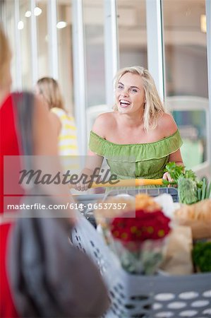 Women pushing shopping cart Stock Photo - Premium Royalty-Free, Image code: 614-06537357