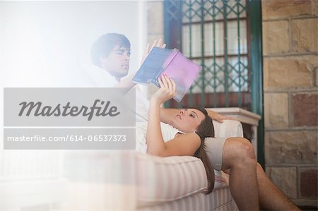 Couple relaxing on sofa together Stock Photo - Premium Royalty-Free, Image code: 614-06537373