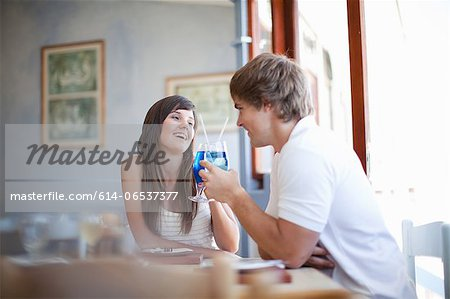 Couple toasting with cocktails Stock Photo - Premium Royalty-Free, Image code: 614-06537377