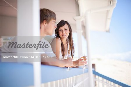 Couple drinking wine together on deck Stock Photo - Premium Royalty-Free, Image code: 614-06537380