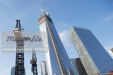 Low angle view of crane and skyscrapers Stock Photo - Premium Royalty-Free, Image code: 614-06537441