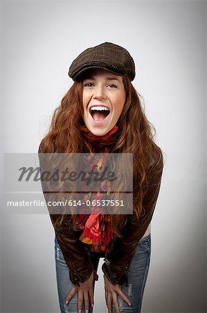 Laughing woman leaning on knees Stock Photo - Premium Royalty-Free, Image code: 614-06537551