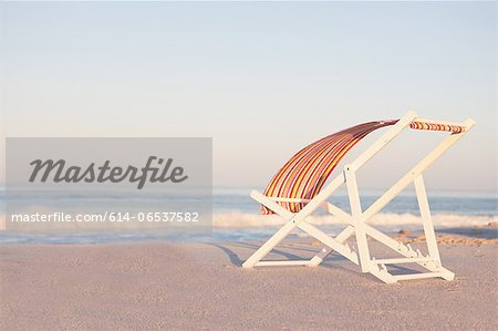 Lawn chair on empty beach Stock Photo - Premium Royalty-Free, Image code: 614-06537582