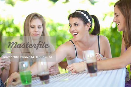 Women playing cards at table Stock Photo - Premium Royalty-Free, Image code: 614-06537634