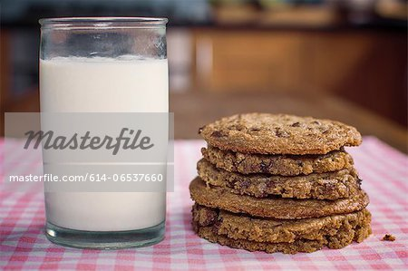 Stack of chocolate chip cookies and milk Stock Photo - Premium Royalty-Free, Image code: 614-06537660