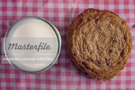 Stack of chocolate chip cookies and milk Stock Photo - Premium Royalty-Free, Image code: 614-06537661
