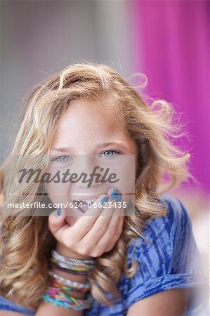 Girl gasping with hand over mouth Stock Photo - Premium Royalty-Free, Image code: 614-06623435