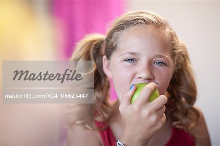 Close up of girl eating apple Stock Photo - Premium Royalty-Free, Image code: 614-06623447