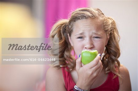 Close up of girl eating apple Stock Photo - Premium Royalty-Free, Image code: 614-06623448