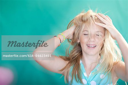 Teenage girl tossing her hair Stock Photo - Premium Royalty-Free, Image code: 614-06623451