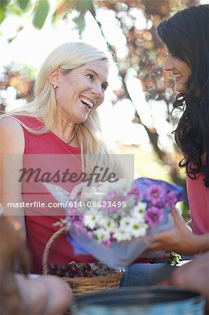 Daughter giving mother flowers Stock Photo - Premium Royalty-Free, Image code: 614-06623495