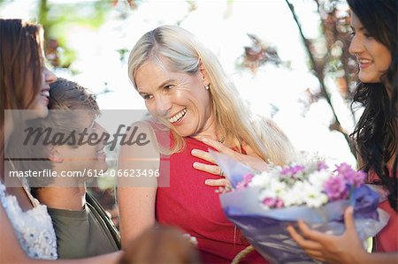 Family smiling at mother Stock Photo - Premium Royalty-Free, Image code: 614-06623496