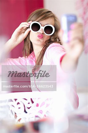 Teenage girl taking picture of herself Stock Photo - Premium Royalty-Free, Image code: 614-06623543