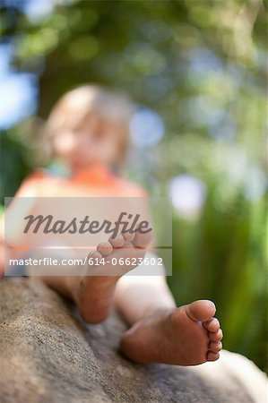 Close up of boy's feet on rock Stock Photo - Premium Royalty-Free, Image code: 614-06623602
