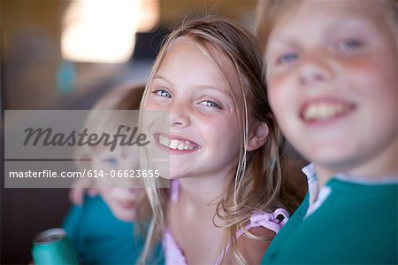 Children drinking soda in garage Stock Photo - Premium Royalty-Free, Image code: 614-06623655
