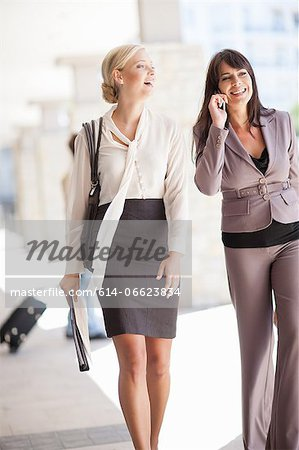 Businesswomen walking together Stock Photo - Premium Royalty-Free, Image code: 614-06623834