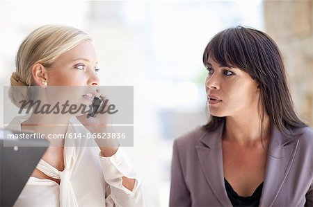 Businesswomen standing outdoors Stock Photo - Premium Royalty-Free, Image code: 614-06623836