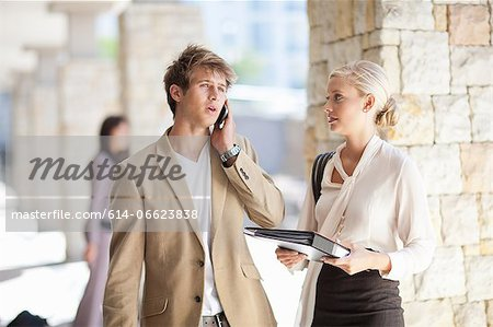 Business people standing in walkway Stock Photo - Premium Royalty-Free, Image code: 614-06623838