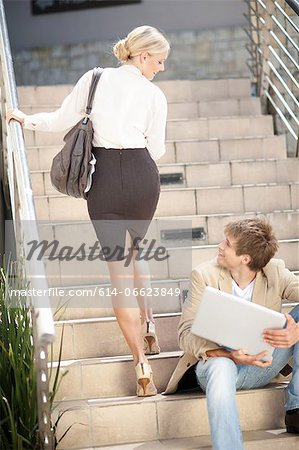 Business people greeting on steps Stock Photo - Premium Royalty-Free, Image code: 614-06623849