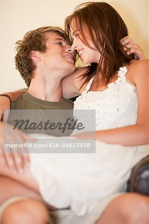 Man holding girlfriend on his lap Stock Photo - Premium Royalty-Free, Image code: 614-06623938