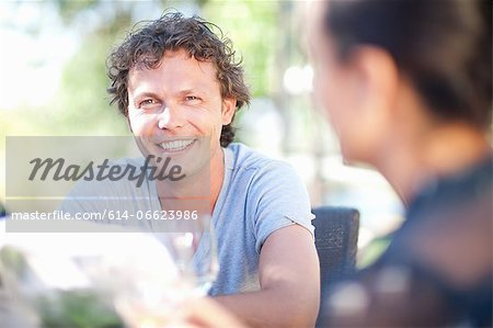 Friends having drinks at table outdoors Stock Photo - Premium Royalty-Free, Image code: 614-06623986