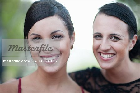 Women smiling together outdoors Stock Photo - Premium Royalty-Free, Image code: 614-06624003
